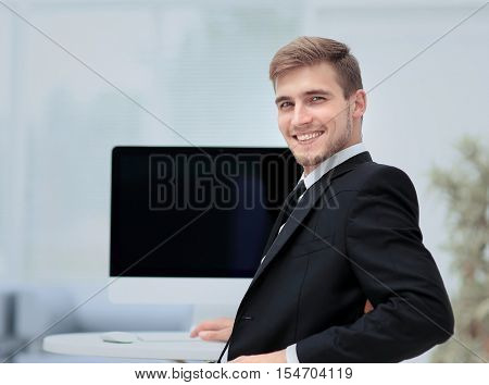 Image of businessman working in office in front  his laptop co