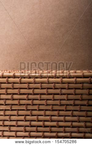 Straw mat and brown background for background usage