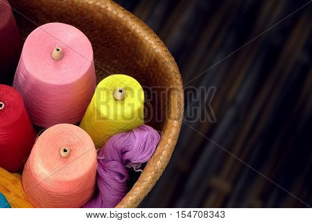 Spools of colored silk thread for woven in silk in Thailand.