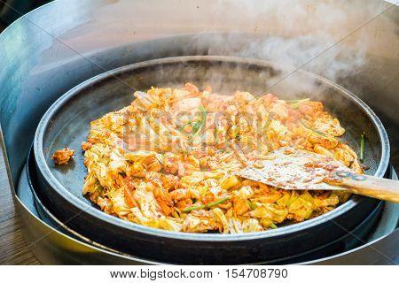 One of Korean favorite : Korean spicy stir fried vegetable, chicken and Korean spicy sauce (Gochujang) in big hot pan know as Dak Galbi