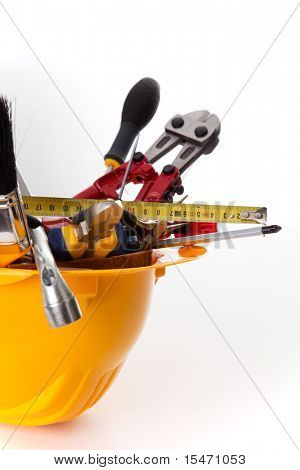 a mix of construction tools over a white background (selective focus)