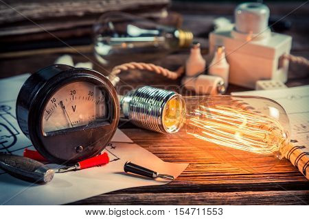 In the Edison's laboratory on old wooden table