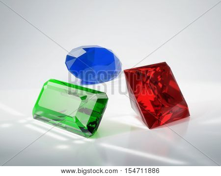 Beautiful gems emerald, ruby and sapphire. 3D illustration.