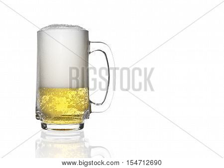 front view frosty light beer and many white bubbles in clear glass with handle and steam for winter drink or celebration isolated on white background and reflection for beer glass with space