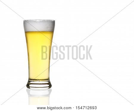 front view frosty light beer full glass in clear glass with white bubbles and steam for winter drink or celebration isolated on white background and reflection for beer glass with space