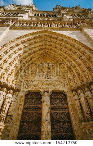 Close up of Notre Dame entrance doorway arch and carvings