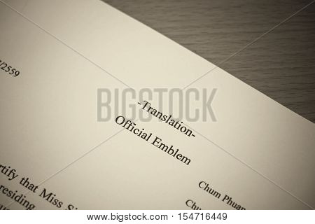 closeup english translation paper on wooden table for service