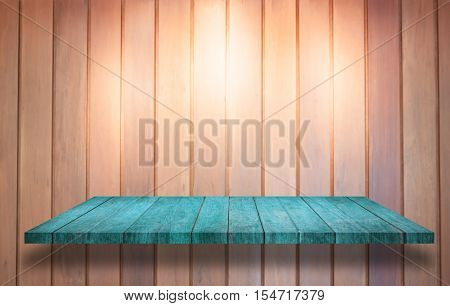 Top of blue wooden shelf with spot light on wooden wall background, stock photo