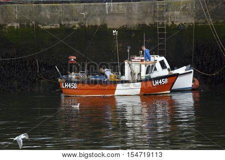 Fisherman working in Eyemouth harbour Berwickshire in Scotland UK. 07.08.2016