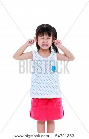 Child Putting Finger On Her Ears. Isolated On White Background.