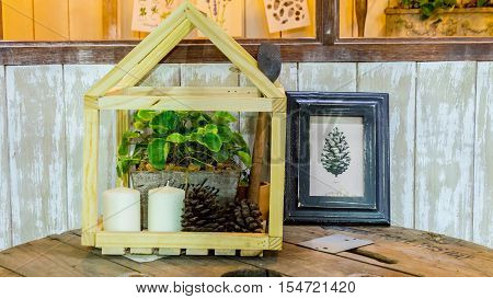 Hanging leave pictures in antique wooden picture frame.