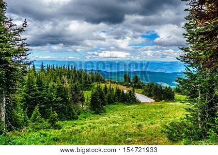 View of the Shuswap Highlands in central British Columbia and an Alpine Meadow with a Snow Patch in Summer