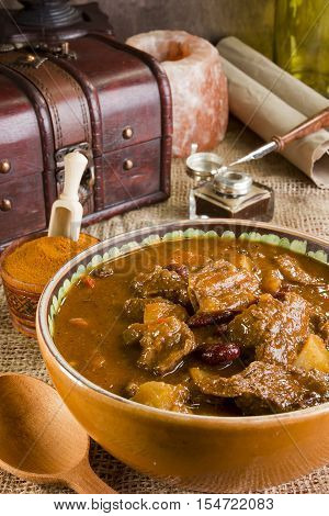 Traditional Hungarian hot homemade goulash soup and ground paprika