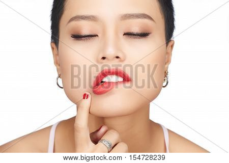 Face of cheeky woman with bright red lips