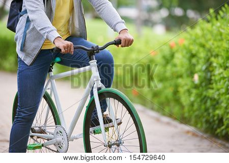 Cropped image of man on bicycle outdoors