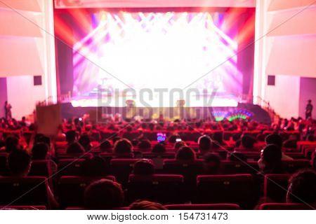blur of theator,people looking contert