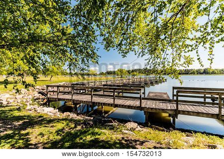Boat dock on lake at Mount Trashmore Park in Virginia Beach, Virginia.