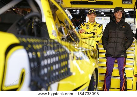 Martinsville, VA - Oct 29, 2016: Denny Hamlin (11) and Matt Kenseth (20) chat beofre practicing for the Goody's Fast Relief 500 at Martinsville Speedway in Martinsville, VA.