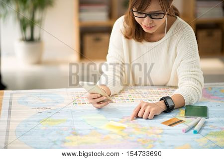 Young woman searching for information about the country she is going to visit