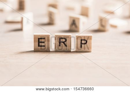 Enterprise Resource Planning collected of wooden elements with the letters