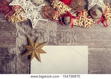 Christmas Letter On Wooden Background With Ornaments Arround