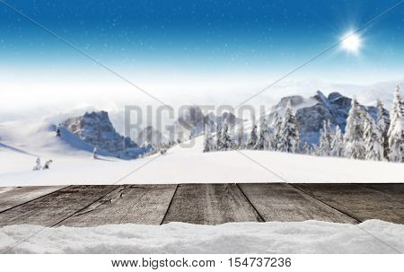 Empty wooden planks with winter alpine high mountains. Ideal for product placement