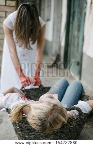 Killer woman hide dead body, halloween concept