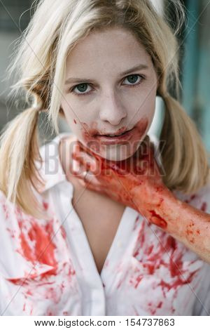 Suffocated blonde woman. Hand strangle blood covered blonde woman