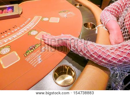 Las Vegas United States of America - May 11 2016: The woman sitting at the card game table in the Fremont Casino at Las Vegas United States of America