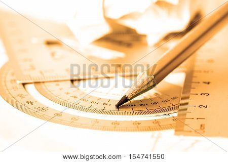 selective focus of the pencil with precision measurement tool golden color tone