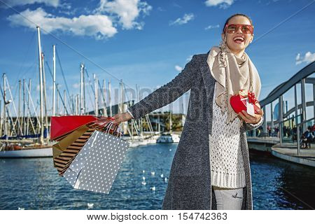 Woman With Christmas Present Box Looking Into The Distance