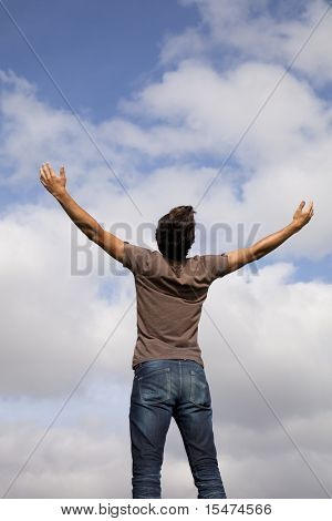 young teenager with the arms outstretched in outdoor