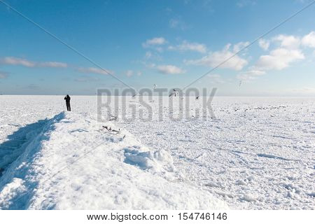 The picture was taken in Ukraine in Odessa. Due to the extremely severe frosts all Odessa bay covered with ice. On the horizon are visible steamers. It seems that they can be reached on foot.