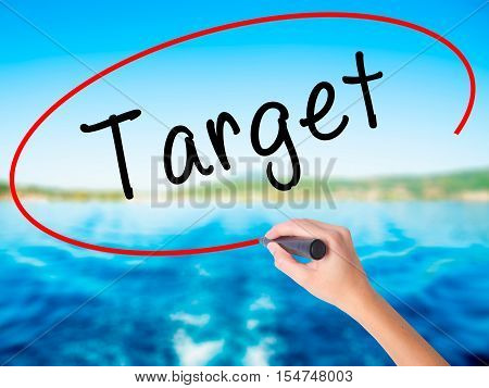 Woman Hand Writing Target With A Marker Over Transparent Board