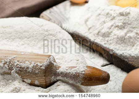 Rolling pin with flour close up. Copy space. Bakery background
