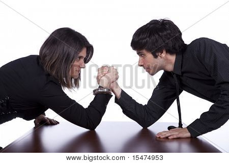 Men and woman in a arm wrestling at the office