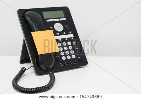 isolated mock up sticky note on IP phone