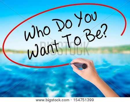 Woman Hand Writing Who Do You Want To Be? With A Marker Over Transparent Board
