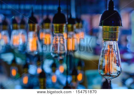 beautiful incandescent lamps hang from the ceiling