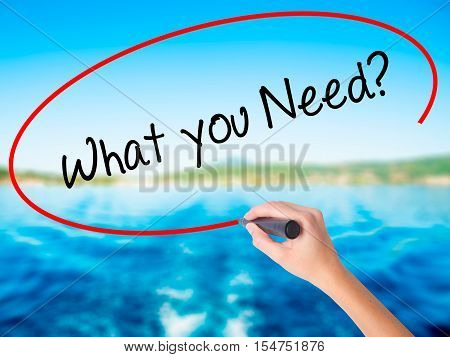 Woman Hand Writing  We Need You? With A Marker Over Transparent Board