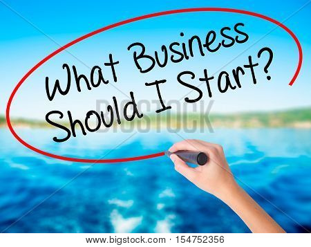Woman Hand Writing What Business Should I Start? With A Marker Over Transparent Board