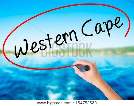 Woman Hand Writing Western Cape With A Marker Over Transparent Board.