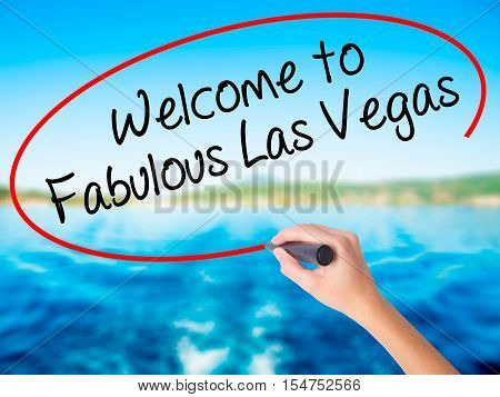 Woman Hand Writing Welcome To Fabulous Las Vegas With A Marker Over Transparent Board