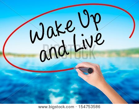 Woman Hand Writing Wake Up And Live With A Marker Over Transparent Board.