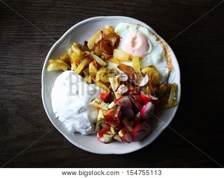 Fresh salad cottage cheese and fried egg on a plate