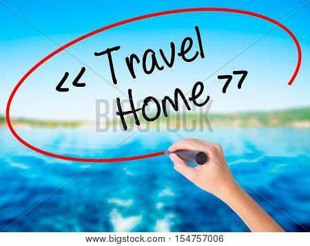 Woman Hand Writing Travel - Home With A Marker Over Transparent Board