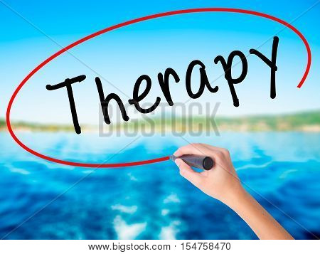 Woman Hand Writing Therapy With A Marker Over Transparent Board