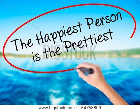 Woman Hand Writing The Happiest Person Is The Prettiest With A Marker Over Transparent Board.