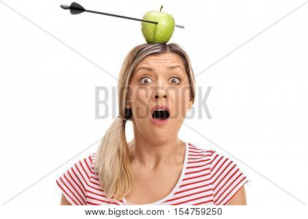 Terrified young woman posing with an apple pierced by an arrow on her head isolated on white background
