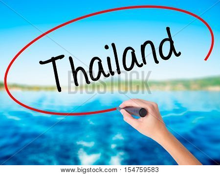 Woman Hand Writing Thailand  With A Marker Over Transparent Board